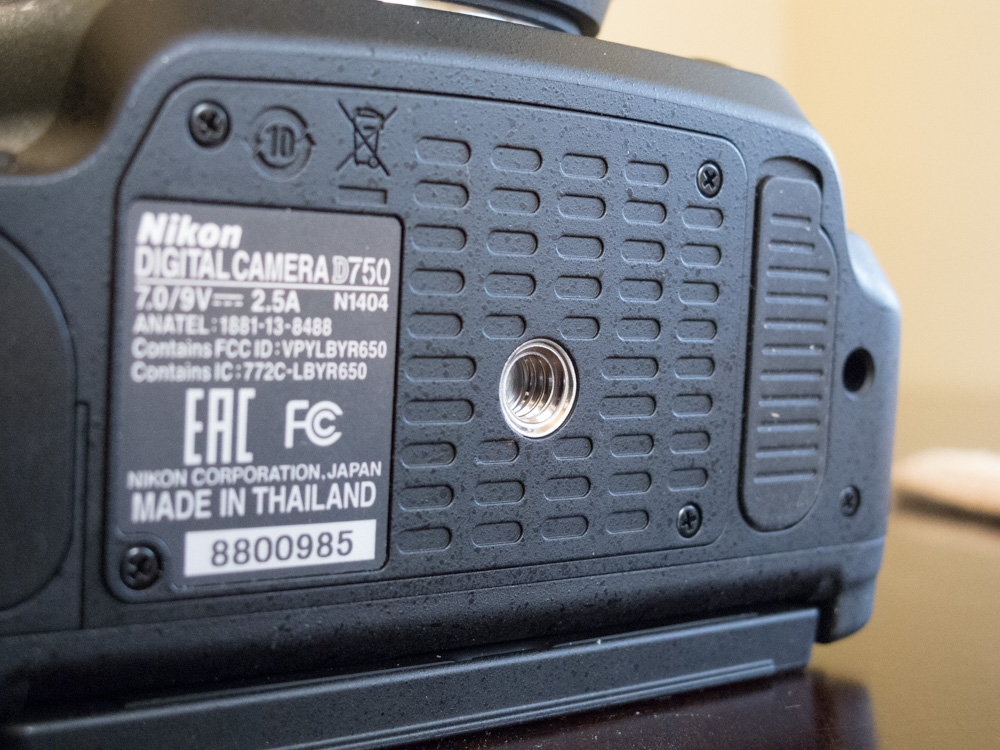 The Nikon D750 lacks a rubberized bottom plate.